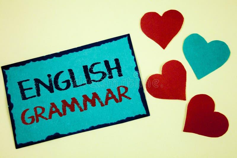 Engelsk grammatik för ordhandstiltext Affärsidé för idé för anmärkning för turkos för litteratur för språkkunskapsskolutbildning  royaltyfria foton