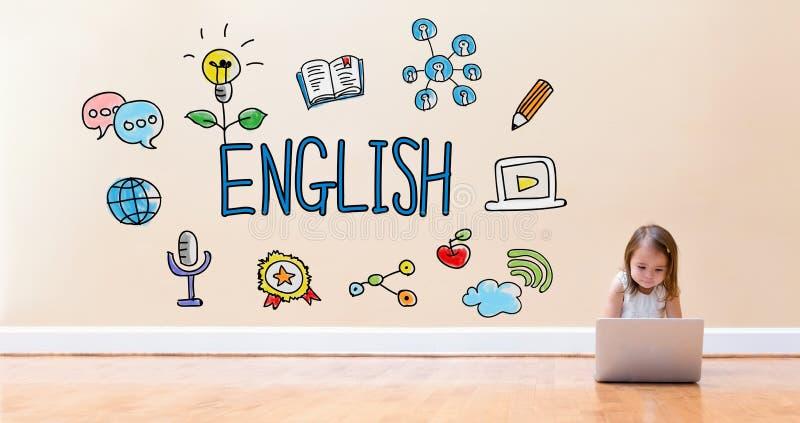 Engelsk text med lilla flickan som använder en bärbar datordator arkivfoton