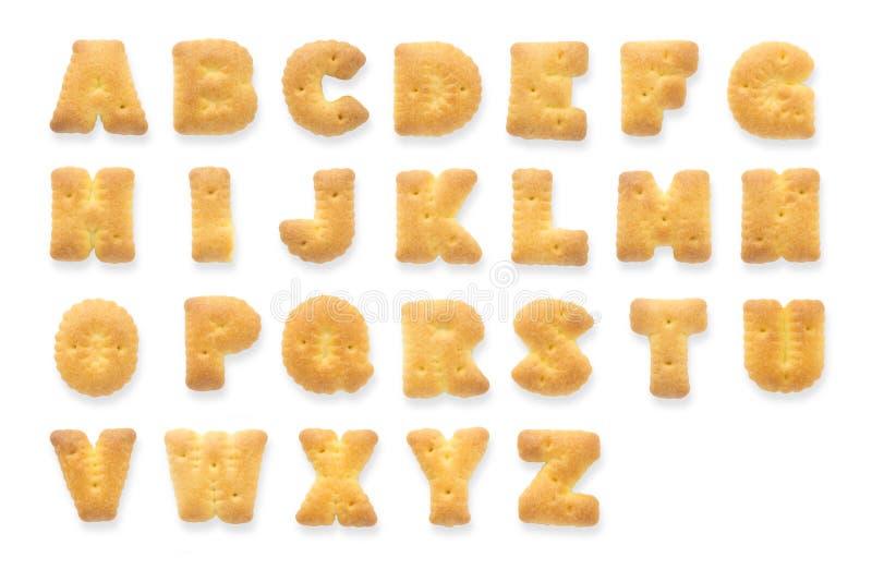 Engelska alfabet, collage av 26 isolerade ljusbruna kakabokstäver fotografering för bildbyråer