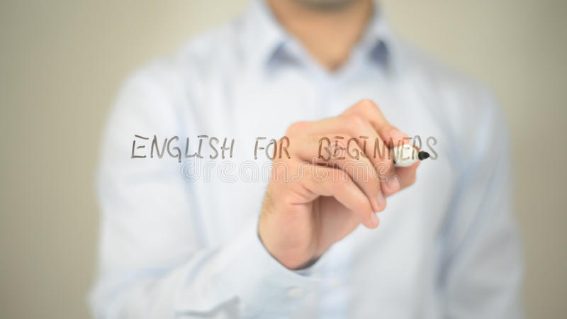 Engelska för nybörjare, manhandstil på den genomskinliga skärmen royaltyfri fotografi