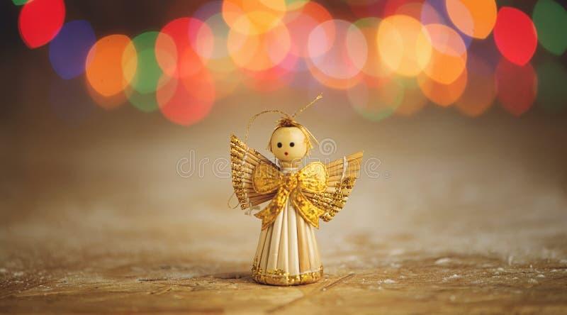 Engelspuppe Weihnachtsdekorationen Bokeh Leuchten stockfotografie
