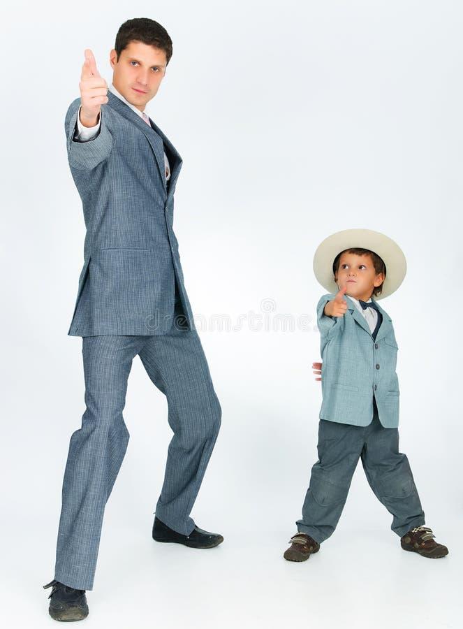 Engendrez avec un jeune fils, rectifié dans un procès photographie stock libre de droits
