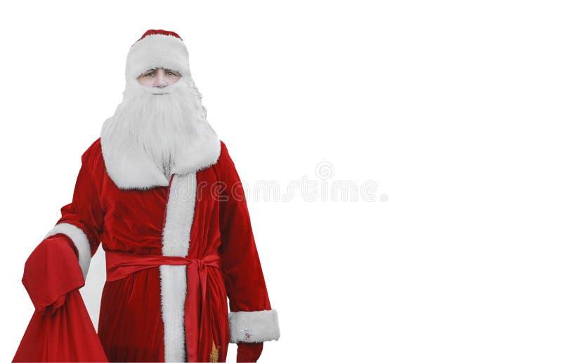 Engendrez Christmas, Santa Claus est dans les bois avec un sac des cadeaux photos stock