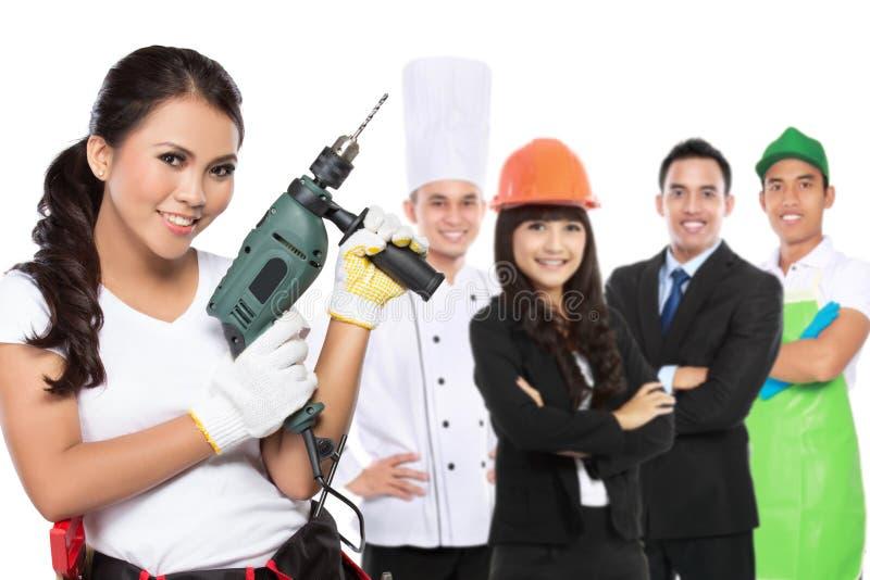 Engenharia fêmea e a outra profissão fotografia de stock