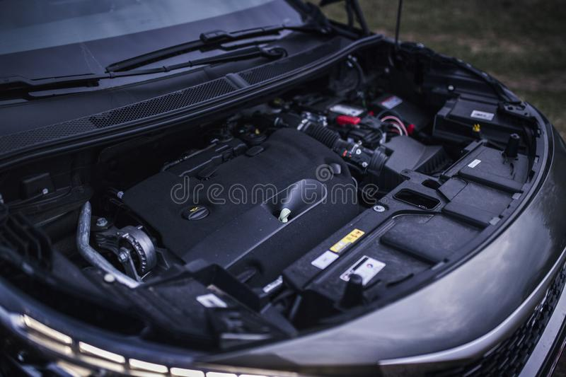 Engine Bay In a Car. View of an engine bay inside a car. Diesel engine with engine cover details royalty free stock images
