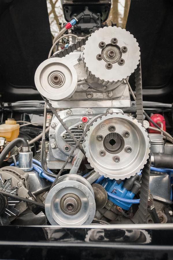 Vehicle engine bay and supercharger. Engine bay and supercharger on a high performance car stock images