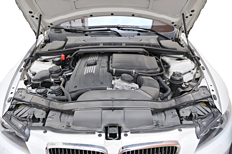 Engine of BMW 335i car - bonnet open position. Engine of BMW 335i convertible sports car. Bonnet open position. Can see detail of engine royalty free stock image