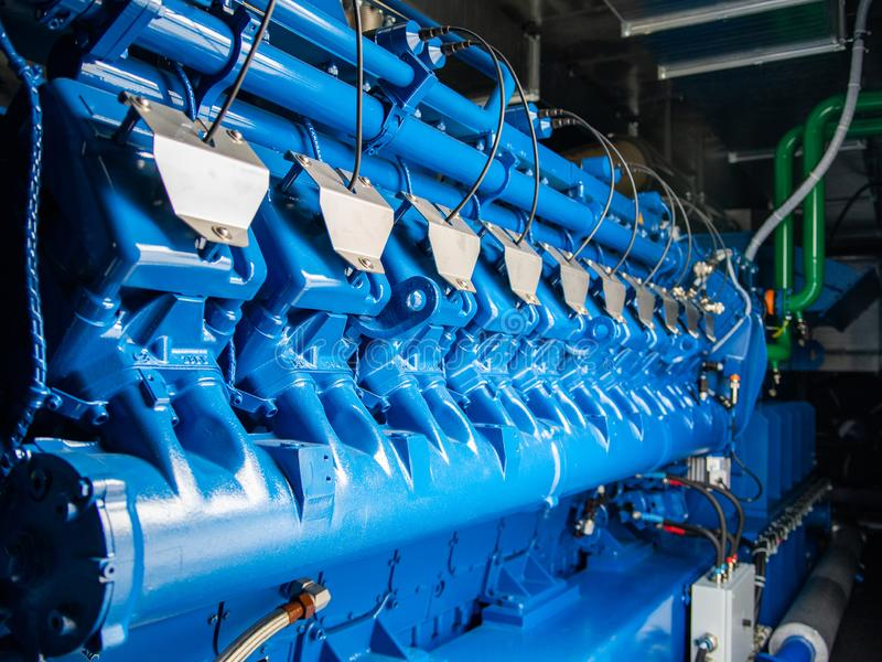 Engine of CHP unit. Diesel and gas industrial electric generator. Alternative energy for industry, electricity, cogeneration, trigeneration, equipment, fuel stock photo