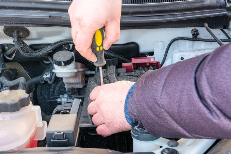 Engine engineer is replacing car battery because car battery is depleted. concept car maintenance stock image