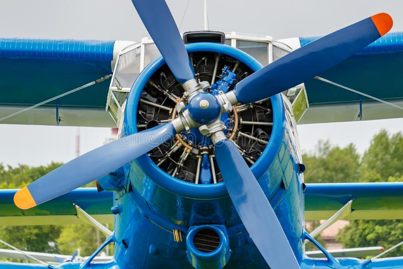 Engine with four blade propeller and pilots cabin of soviet aircraft biplane Antonov AN-2 closeup royalty free stock image