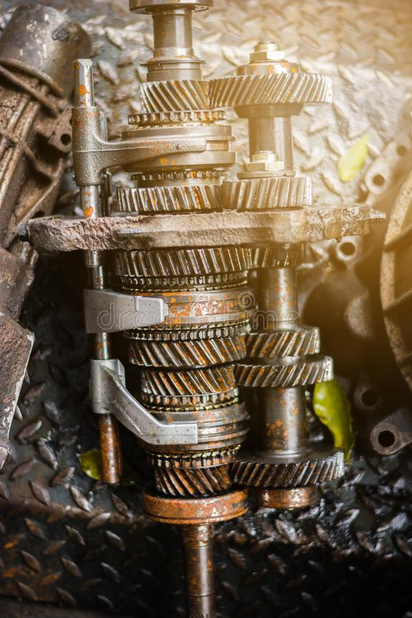 Engine gear wheel remove from car. With dirty oil and rust stock photo