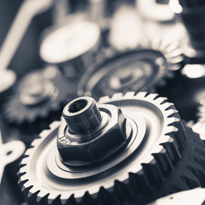 Engine gear wheels. Industrial background stock image