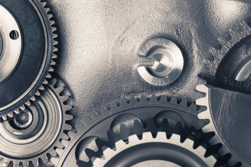 Engine gear wheels. Industrial background with copy-space royalty free stock photos