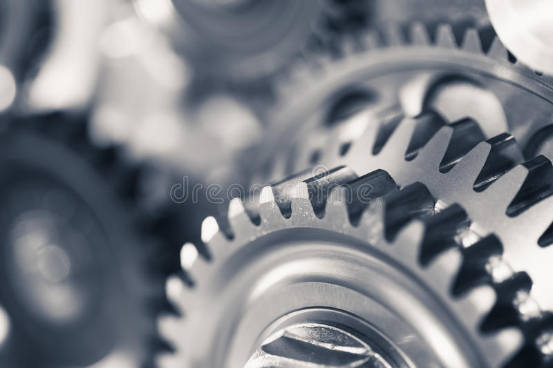 Engine gear wheels. Industrial background with copy-space stock photos
