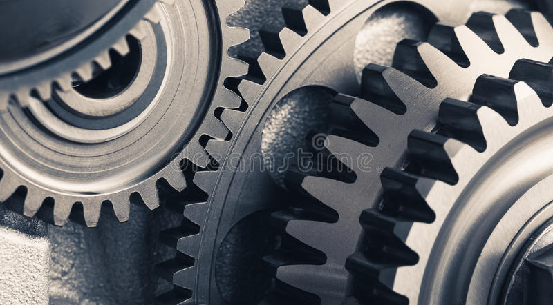 Engine gear wheels, industrial background royalty free stock photography