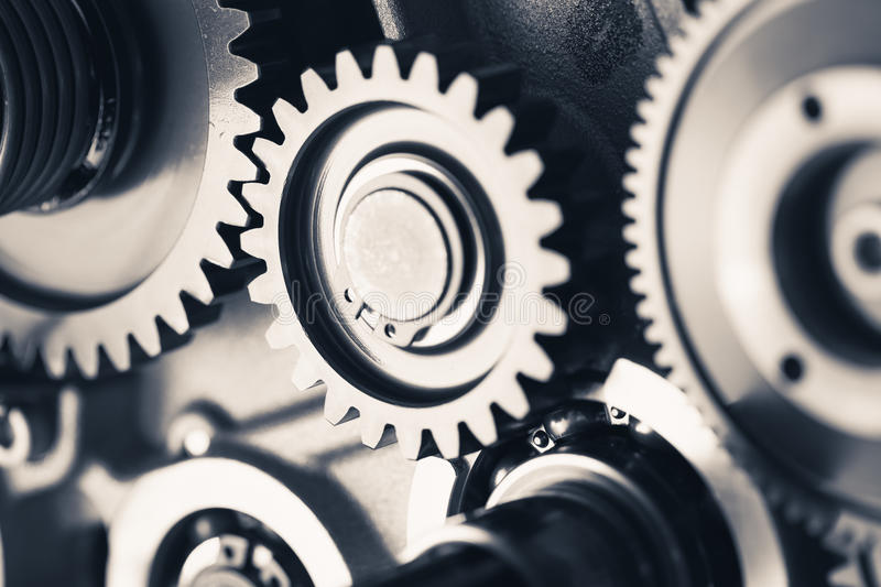Engine gear wheels, industrial background. Teamwork concept royalty free stock photo