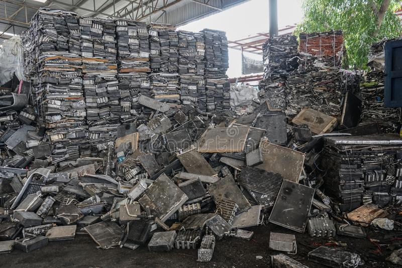 Engine junkyard. That old, cracked engine block may still have some life in it: it`s recyclable. Several businesses devote themsel. Scrap yard for recycle the stock photography