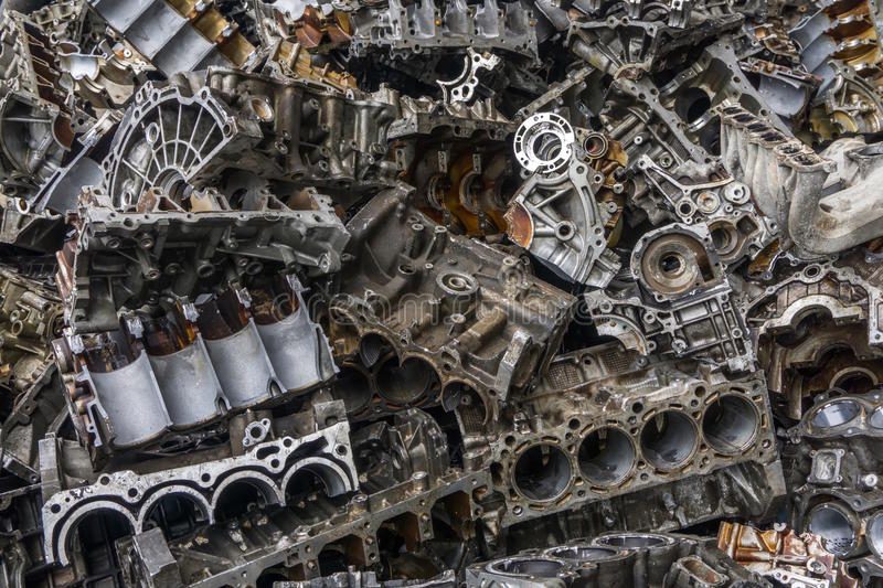 Engine junkyard. That old, cracked engine block may still have some life in it: it`s recyclable. Several businesses devote themselves to the removal of such stock image