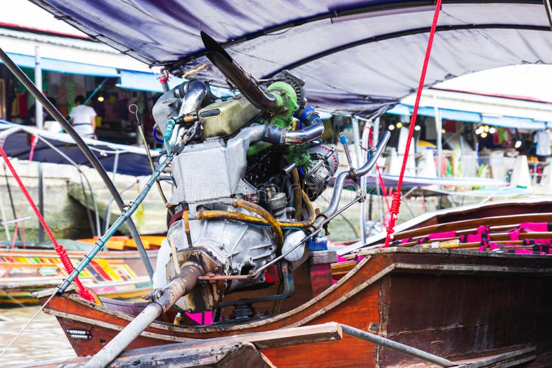 Engine on a longtail boat of amphawa floating market is the tourist most popular in Samut Songkhram, thailand.  royalty free stock photography