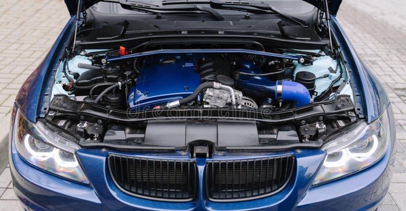 Engine motor of blue car under hood stock photo