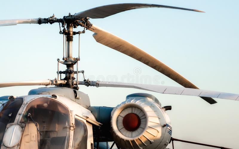 Engine and propeller blades of an old vintage helicopter. Against a blue sky royalty free stock images