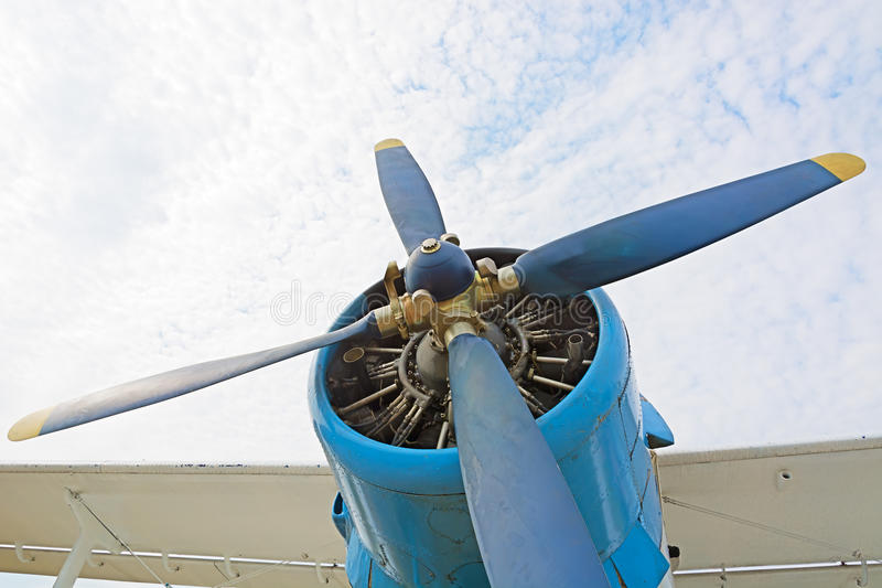The engine and propeller plane AN2. The engine and propeller plane AN2 close-up on a background of blue sky and clouds. The picture at the low point royalty free stock image