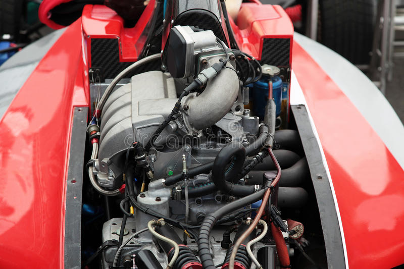 Engine of a racing race car. Precision muscle car engine that produce intense horsepower and incredible speed stock photos