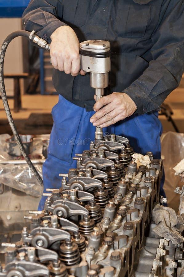 Engine repair. The tool in hands. Engine repair close up. In hands tool stock images