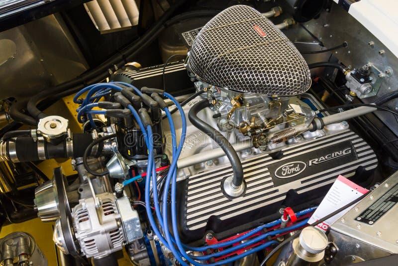 Engine of a roadster Shelby AC Cobra 427, 1966. BERLIN - JUNE 14, 2015: Engine of a roadster Shelby AC Cobra 427, 1966. The Classic Days on Kurfuerstendamm royalty free stock image