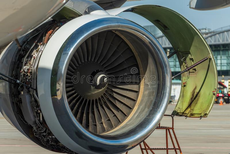 Engine`s maintenance in airport. Repair and preparation of the aircraft before departure.  royalty free stock image
