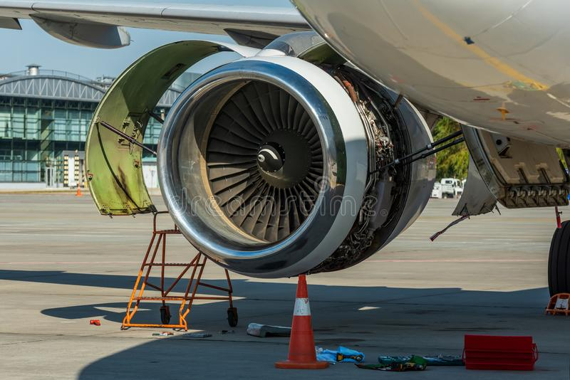 Engine`s maintenance in airport. Repair and preparation of the aircraft before departure.  stock images