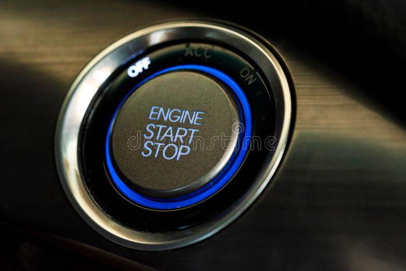 Engine start button in modern car close royalty free stock photography