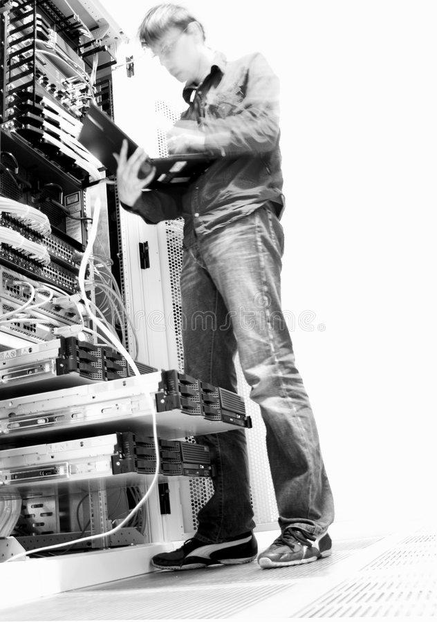 IT Engineer. Engineer Configuring IT Equipment - Black and White