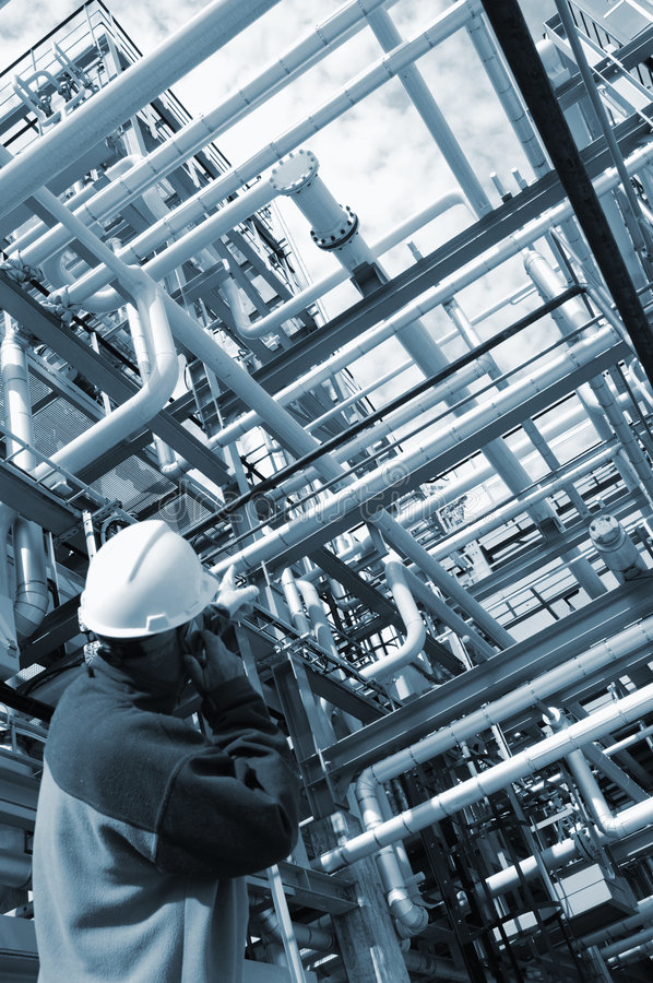 Engineer against pipelines stock photography