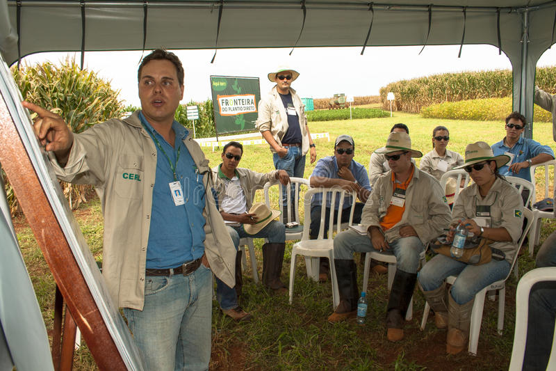 Engineer agronomist teaches. Santa Helena, Goias, Brazil, March 05, 2009. Engineer agronomist teaches a technical training on seeds for improvement of employees stock photo