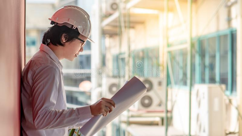 Engineer or Architect checking architectural drawing stock images