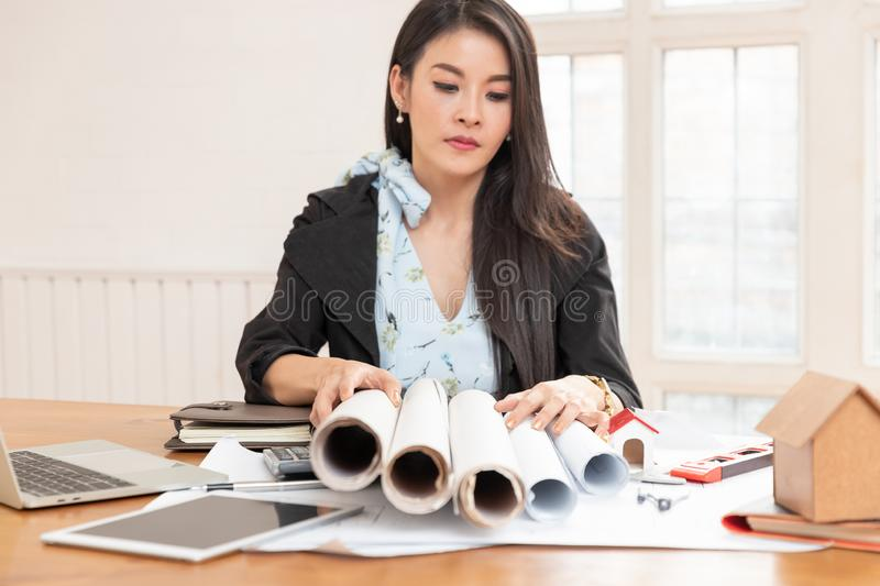Engineer and Architect concept, Engineer Architects office team stress with blueprints workload.  royalty free stock images