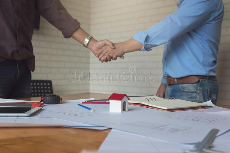 Engineer and Architect concept, Engineer Architects and real estate agent office team shaking hands in office royalty free stock photo