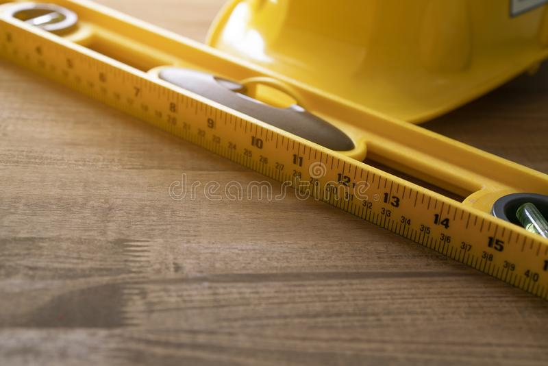 Engineer or architect desk background with helmet and water level in the office royalty free stock image