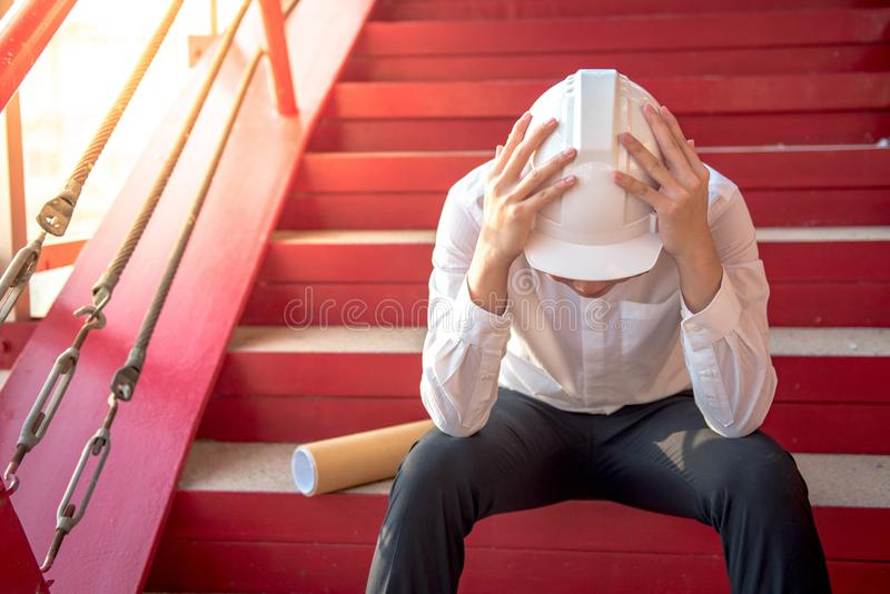 Engineer or Architect feeling tired and headache royalty free stock photography