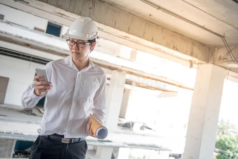 Engineer or Architect using smartphone at construction site stock photos
