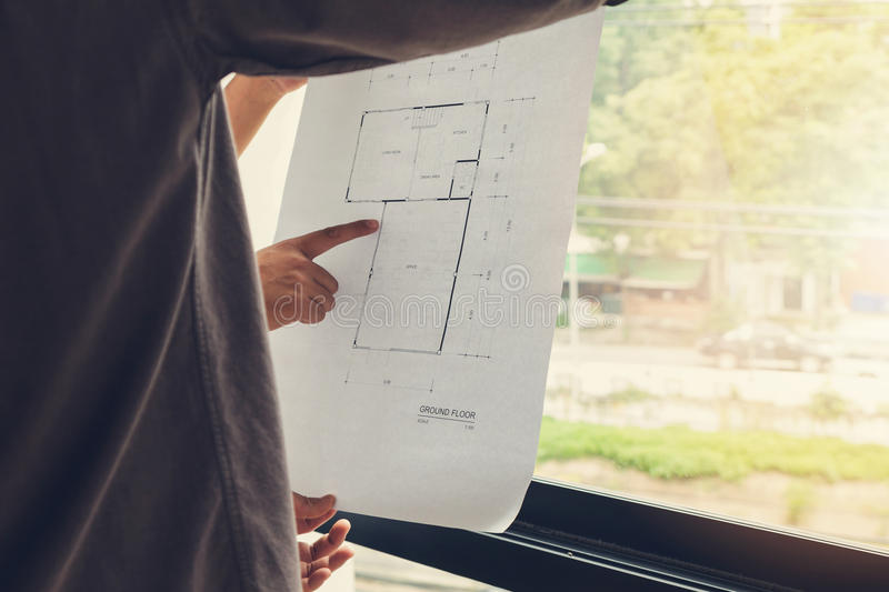 Engineer Architects office team working and discussing house plan with blueprints and house mode. Engineer and Architect concept, Engineer Architects office team stock photography