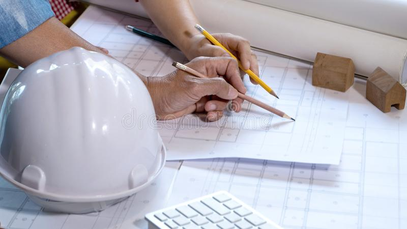engineer or architectural project, working on blueprint royalty free stock photography