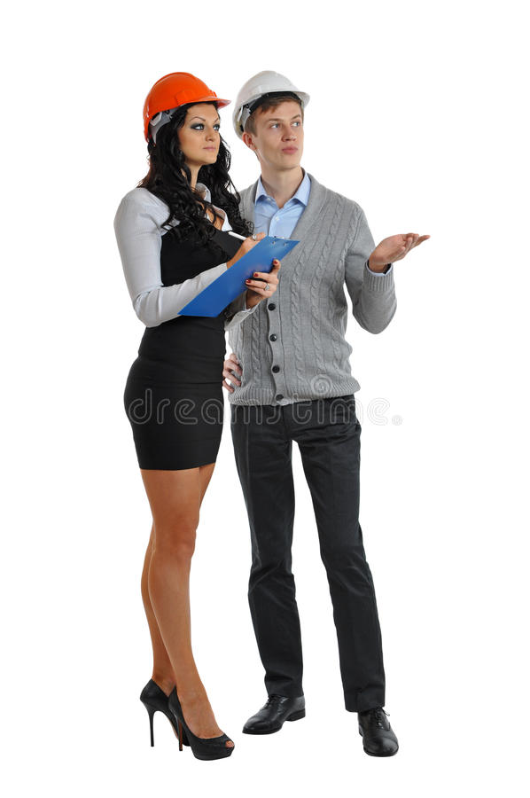 Engineer and assistant in helmets stock photos