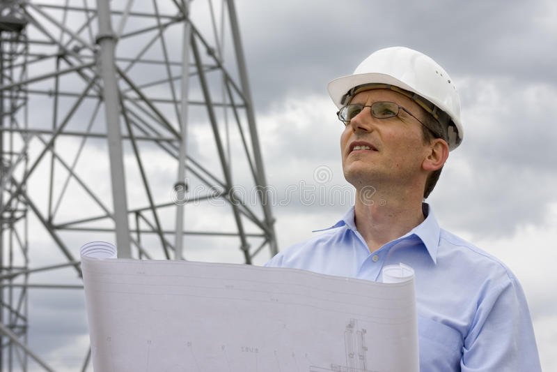 Engineer with blueprint
