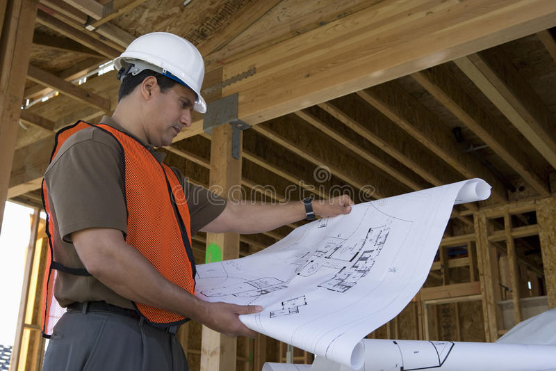 Engineer With Blueprint At Site royalty free stock images