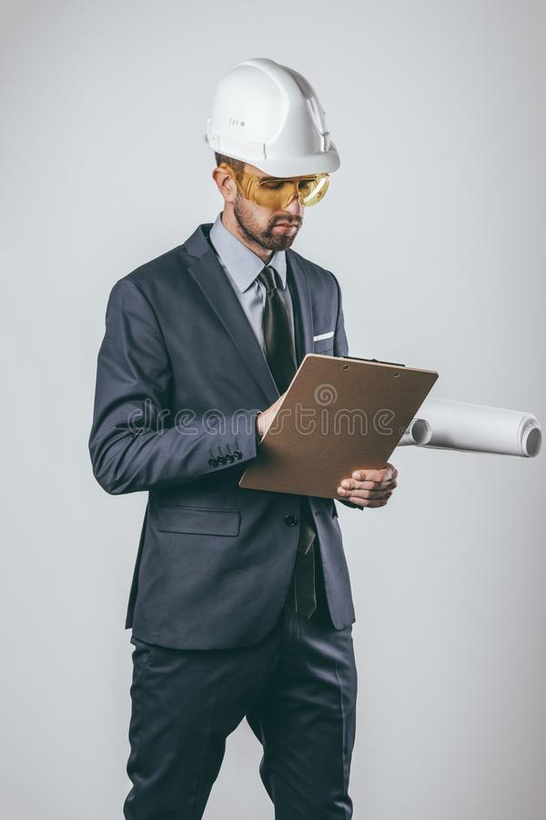 Engineer with blueprints and clipboard royalty free stock images