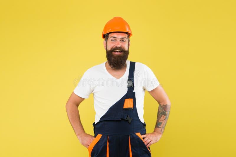 Engineer builder in uniform. Building improvement and renovation. Brutal man builder. Man builder hard hat. Renovating stock photo