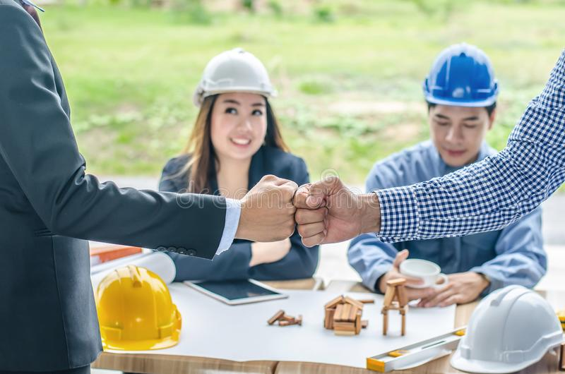 Engineer and businessman handshake, Teamwork between professional construction engineers after project complete , stock photography