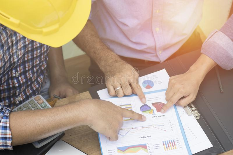 Engineer and businessman pointin royalty free stock photos